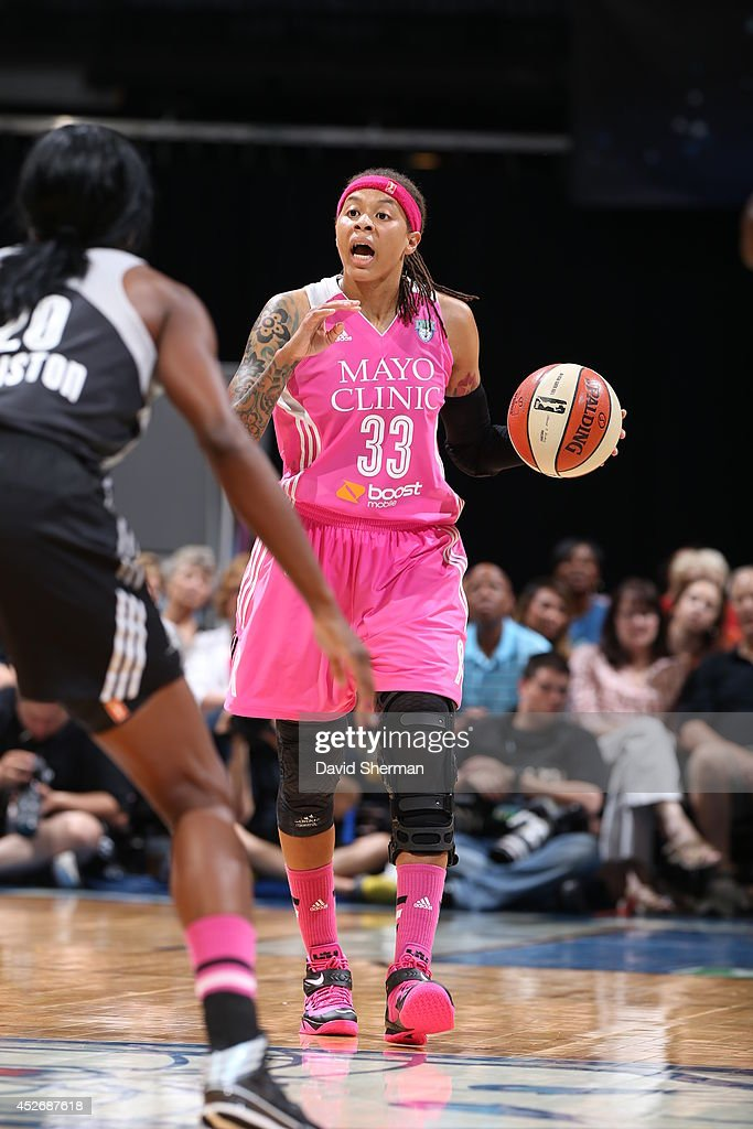 Seimone Augustus #33 of the Minnesota Lynx moves the ball up-court against the San Antonio Stars during the WNBA game on July 25, 2014 at Target Center in Minneapolis, Minnesota.