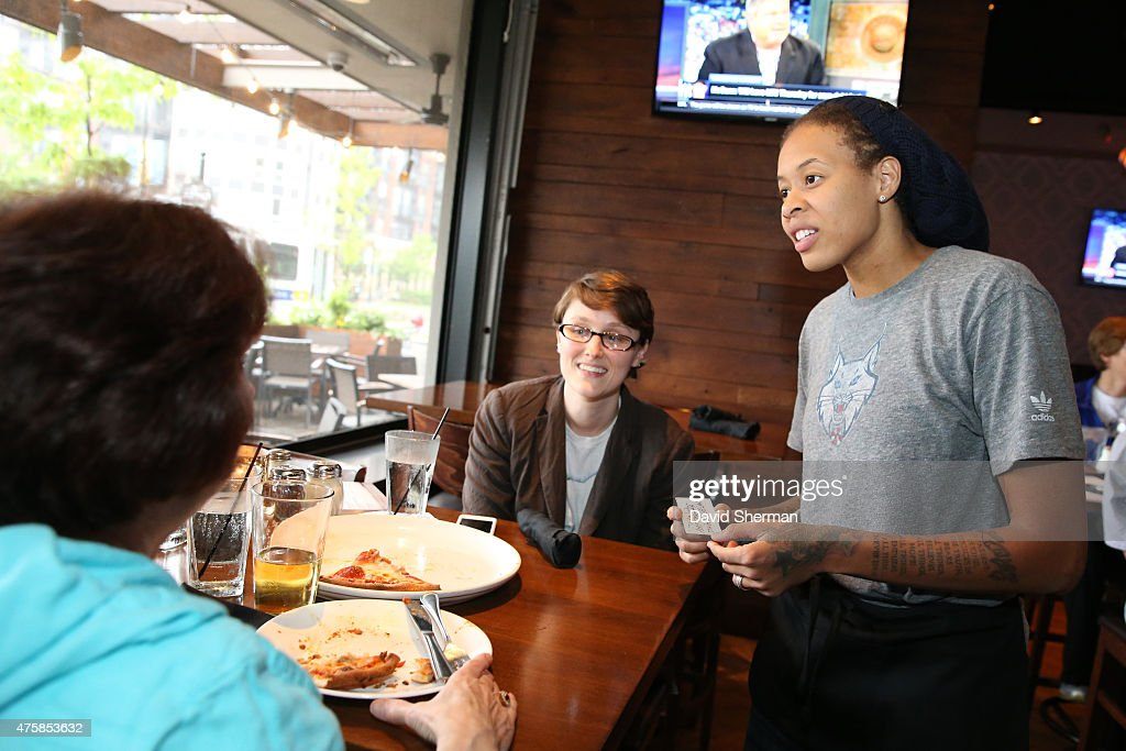 <a gi-track='captionPersonalityLinkClicked' href=/galleries/search?phrase=Seimone+Augustus&family=editorial&specificpeople=540457 ng-click='$event.stopPropagation()'>Seimone Augustus</a> #33 of the Minnesota Lynx participates in the Tip-A-Lynx fundraiser to benefit the Minnesota Lynx Fastbreak Foundation on June 3, 2015 at the Loop West End Bar & Restaurant in Minneapolis, Minnesota.