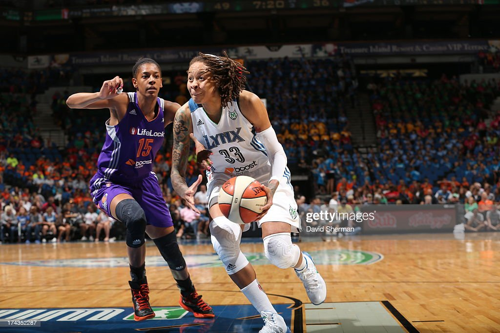 <a gi-track='captionPersonalityLinkClicked' href=/galleries/search?phrase=Seimone+Augustus&family=editorial&specificpeople=540457 ng-click='$event.stopPropagation()'>Seimone Augustus</a> #33 of the Minnesota Lynx prepares to shoot against Briana Gilbreath #15 of the the Phoenix Mercury during the WNBA game on July 24, 2013 at Target Center in Minneapolis, Minnesota.