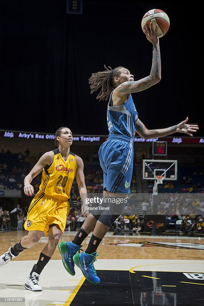 <a gi-track='captionPersonalityLinkClicked' href=/galleries/search?phrase=Seimone+Augustus&family=editorial&specificpeople=540457 ng-click='$event.stopPropagation()'>Seimone Augustus</a> #33 of the Minnesota Lynx puts up a shot against the Tulsa Shock during the WNBA game on June 14, 2013 at the BOK Center in Tulsa, Oklahoma.