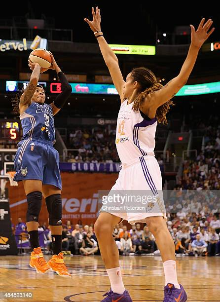 Seimone Augustus of the Minnesota Lynx puts up a shot over Brittney Griner of the Phoenix Mercury during the first half of the game three of the WNBA...
