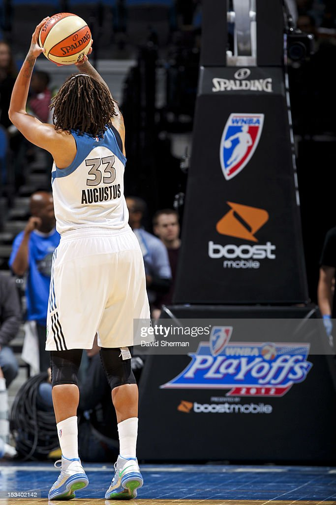 <a gi-track='captionPersonalityLinkClicked' href=/galleries/search?phrase=Seimone+Augustus&family=editorial&specificpeople=540457 ng-click='$event.stopPropagation()'>Seimone Augustus</a> #33 of the Minnesota Lynx shoots a free-throw against the Los Angeles Sparks during Game One of the 2012 WNBA Western Conference Finals on October 4, 2012 at Target Center in Minneapolis, Minnesota.