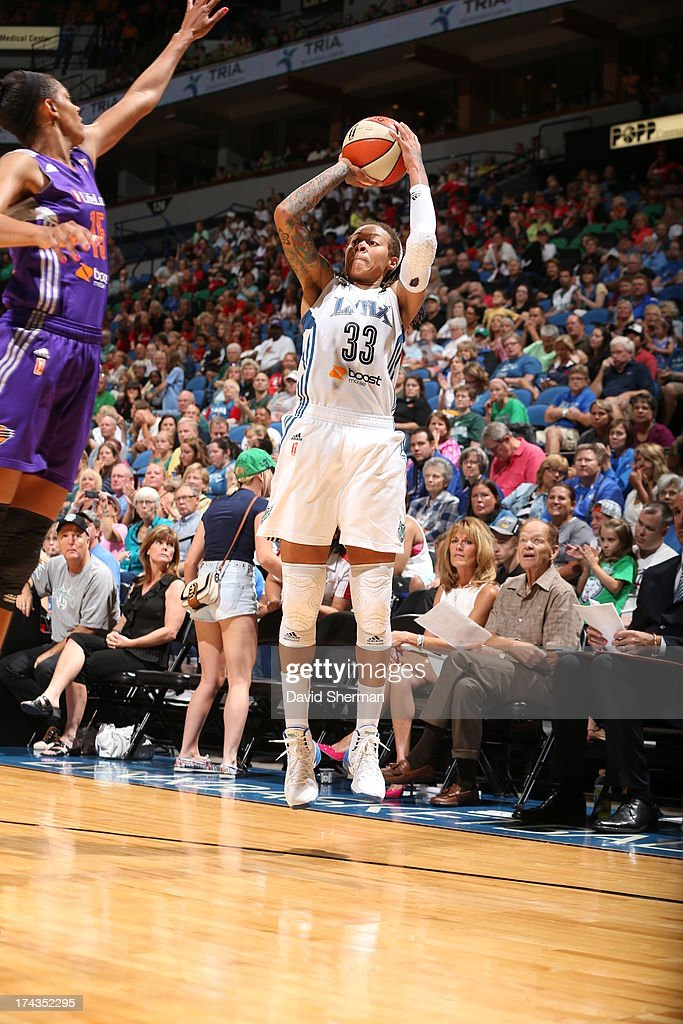 Seimone Augustus #33 of the Minnesota Lynx shoots against Briana Gilbreath #15 of the the Phoenix Mercury during the WNBA game on July 24, 2013 at Target Center in Minneapolis, Minnesota.