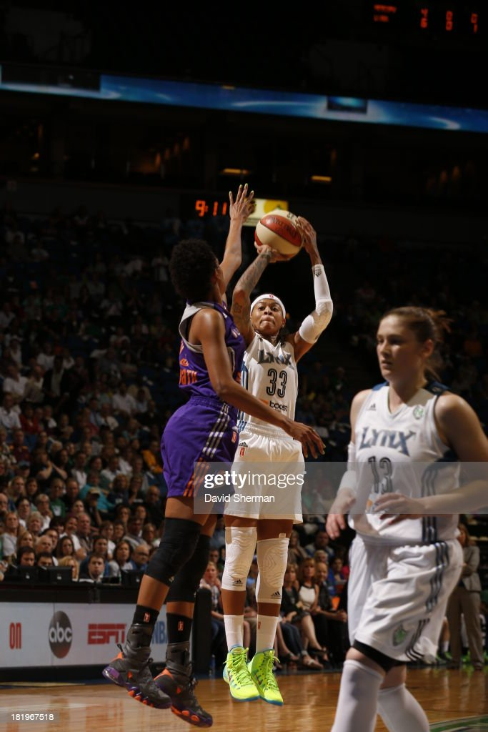<a gi-track='captionPersonalityLinkClicked' href=/galleries/search?phrase=Seimone+Augustus&family=editorial&specificpeople=540457 ng-click='$event.stopPropagation()'>Seimone Augustus</a> #33 of the Minnesota Lynx shoots against Briana Gilbreath #15 of the Phoenix Mercury during the WNBA Western Conference Finals Game 1 on September 26, 2013 at Target Center in Minneapolis, Minnesota.