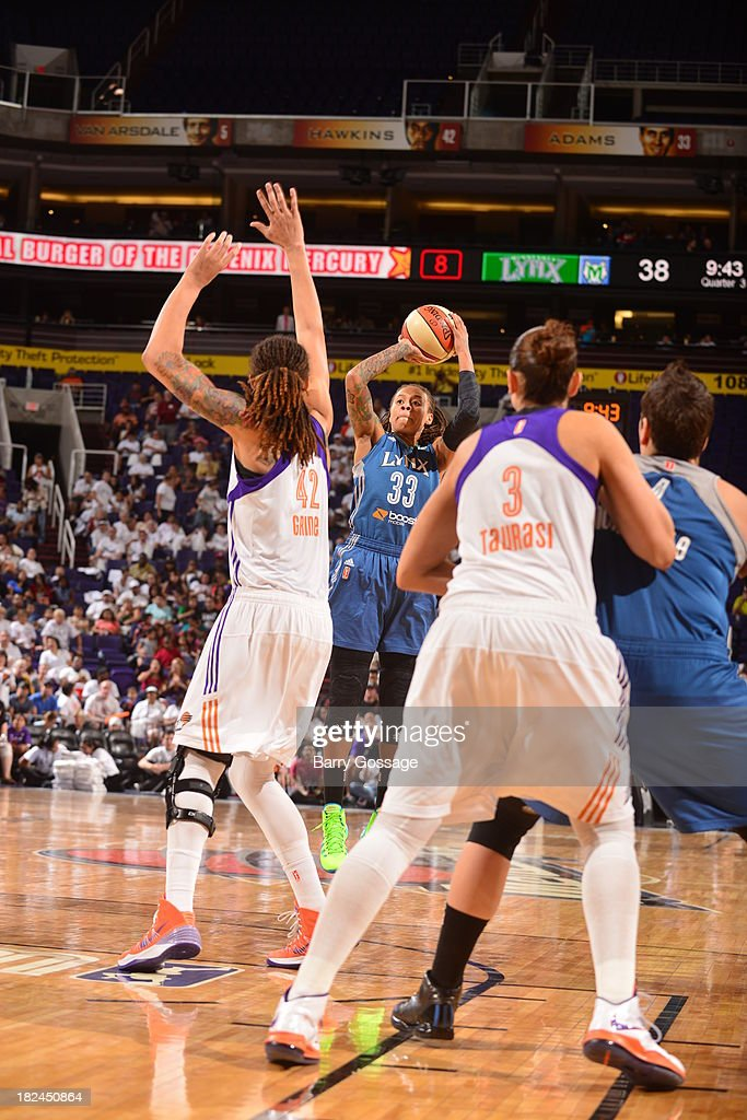 <a gi-track='captionPersonalityLinkClicked' href=/galleries/search?phrase=Seimone+Augustus&family=editorial&specificpeople=540457 ng-click='$event.stopPropagation()'>Seimone Augustus</a> #33 of the Minnesota Lynx shoots against <a gi-track='captionPersonalityLinkClicked' href=/galleries/search?phrase=Brittney+Griner&family=editorial&specificpeople=6836945 ng-click='$event.stopPropagation()'>Brittney Griner</a> #42 of the Phoenix Mercury in Game 2 of the Western Conference Finals during 2013 WNBA Playoffs on September 29, 2013 at U.S. Airways Center in Phoenix, Arizona.
