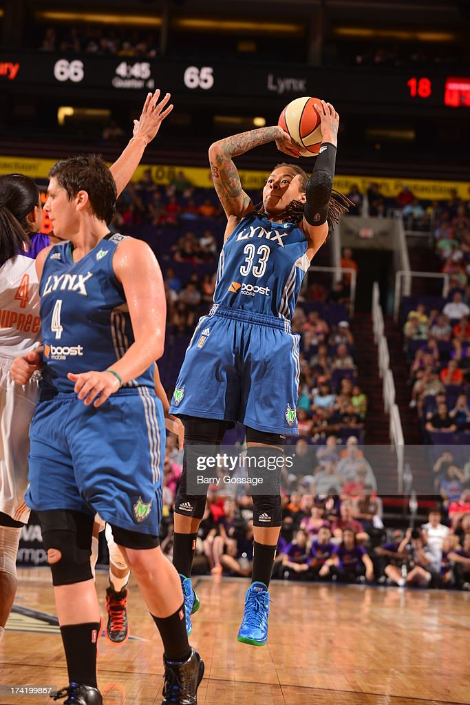 <a gi-track='captionPersonalityLinkClicked' href=/galleries/search?phrase=Seimone+Augustus&family=editorial&specificpeople=540457 ng-click='$event.stopPropagation()'>Seimone Augustus</a> #33 of the Minnesota Lynx shoots against <a gi-track='captionPersonalityLinkClicked' href=/galleries/search?phrase=Candice+Dupree&family=editorial&specificpeople=537818 ng-click='$event.stopPropagation()'>Candice Dupree</a> #4 of the Phoenix Mercury on July 21, 2013 at U.S. Airways Center in Phoenix, Arizona.
