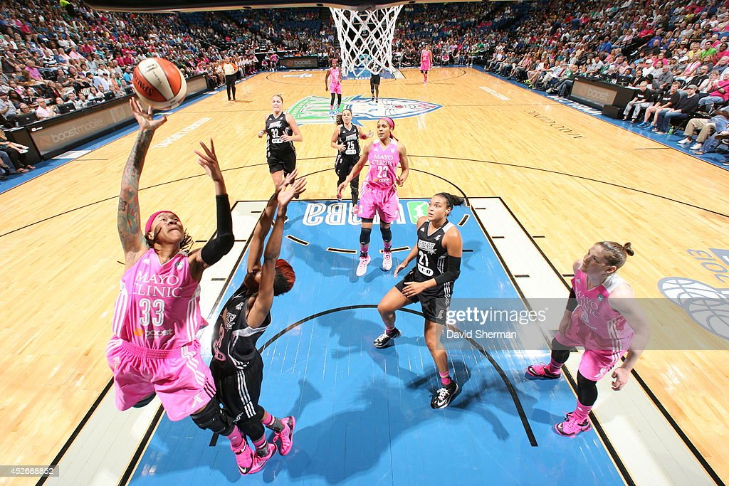<a gi-track='captionPersonalityLinkClicked' href=/galleries/search?phrase=Seimone+Augustus&family=editorial&specificpeople=540457 ng-click='$event.stopPropagation()'>Seimone Augustus</a> #33 of the Minnesota Lynx shoots against Danielle Robinson #13 of the San Antonio Stars during the WNBA game on July 25, 2014 at Target Center in Minneapolis, Minnesota.