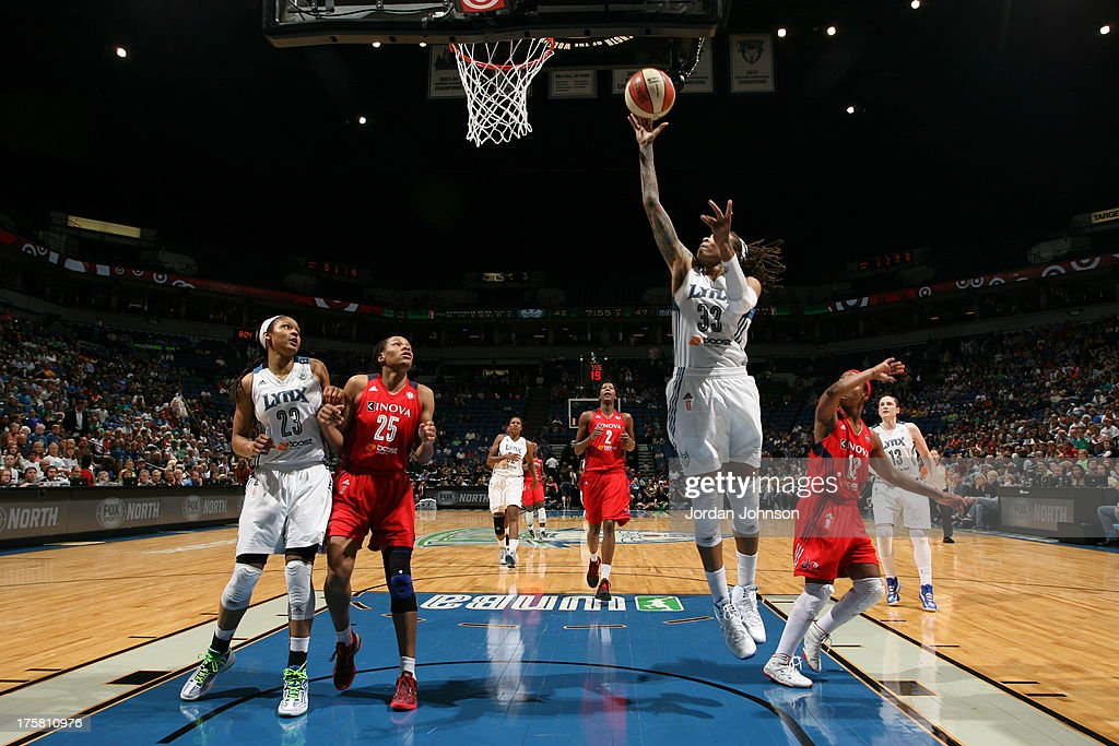 <a gi-track='captionPersonalityLinkClicked' href=/galleries/search?phrase=Seimone+Augustus&family=editorial&specificpeople=540457 ng-click='$event.stopPropagation()'>Seimone Augustus</a> #33 of the Minnesota Lynx shoots against <a gi-track='captionPersonalityLinkClicked' href=/galleries/search?phrase=Ivory+Latta&family=editorial&specificpeople=707962 ng-click='$event.stopPropagation()'>Ivory Latta</a> #12 and Monique Currie #25 of the Washington Mystics during the WNBA game on August 8, 2013 at Target Center in Minneapolis, Minnesota.