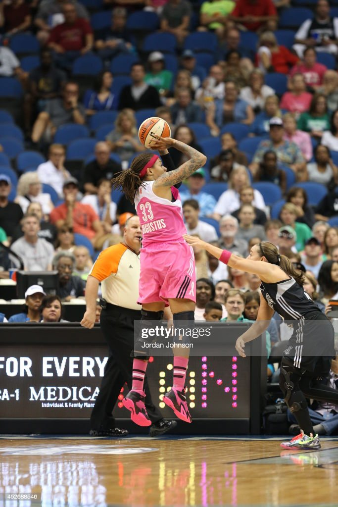 <a gi-track='captionPersonalityLinkClicked' href=/galleries/search?phrase=Seimone+Augustus&family=editorial&specificpeople=540457 ng-click='$event.stopPropagation()'>Seimone Augustus</a> #33 of the Minnesota Lynx shoots against the San Antonio Stars during the WNBA game on July 25, 2014 at Target Center in Minneapolis, Minnesota.