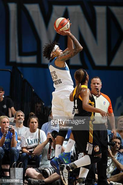 Seimone Augustus of the Minnesota Lynx shoots over Amber Holt of the Tulsa Shock during the game on June 7 2011 at the Target Center in Minneapolis...