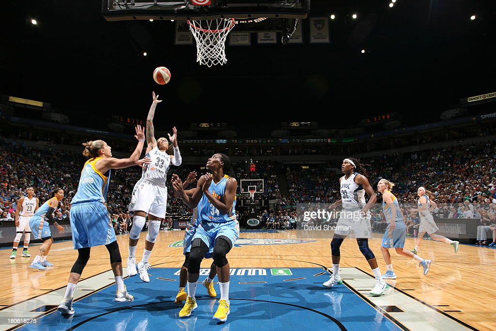 <a gi-track='captionPersonalityLinkClicked' href=/galleries/search?phrase=Seimone+Augustus&family=editorial&specificpeople=540457 ng-click='$event.stopPropagation()'>Seimone Augustus</a> #33 of the Minnesota Lynx shoots over <a gi-track='captionPersonalityLinkClicked' href=/galleries/search?phrase=Elena+Delle+Donne&family=editorial&specificpeople=5042380 ng-click='$event.stopPropagation()'>Elena Delle Donne</a> #11 and Sylvia Fowles #34 of the Chicago Sky during the WNBA game on September 14, 2013 at Target Center in Minneapolis, Minnesota.