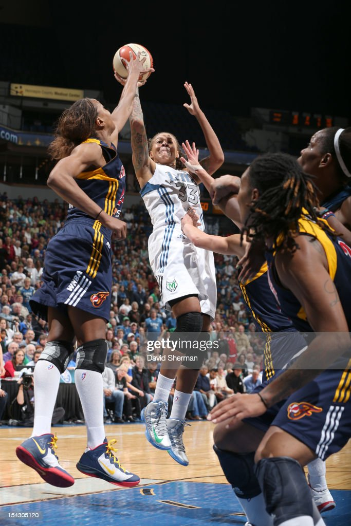 Seimone Augustus #33 of the Minnesota Lynx shoots the ball against Tamika Catchings #24 of the Indiana Fever during the 2012 WNBA Finals Game Two on October 17, 2012 at Target Center in Minneapolis, Minnesota.