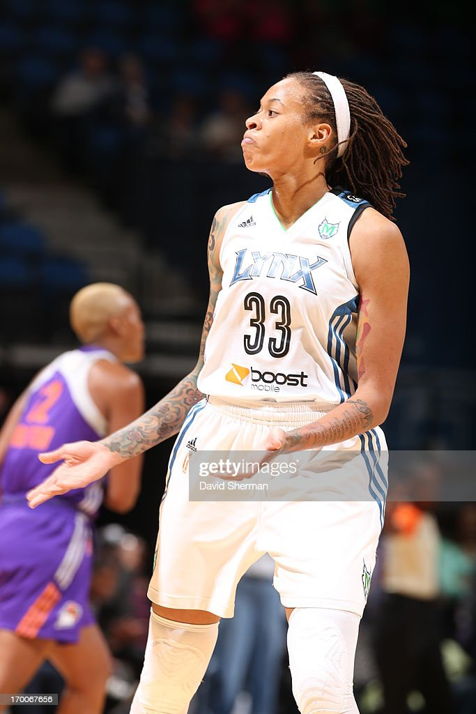 <a gi-track='captionPersonalityLinkClicked' href=/galleries/search?phrase=Seimone+Augustus&family=editorial&specificpeople=540457 ng-click='$event.stopPropagation()'>Seimone Augustus</a> #33 pumps up the crowd during the WNBA game against the Phoenix Mercury on June 6, 2013 at Target Center in Minneapolis, Minnesota.