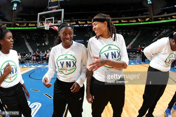 Seimone Augustus talks with Alexis Jones of the Minnesota Lynx before the game against the Atlanta Dream and during the preseason WNBA game on May 5...