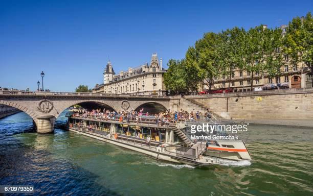 Seine river cruise boat at the Ile de la Cité