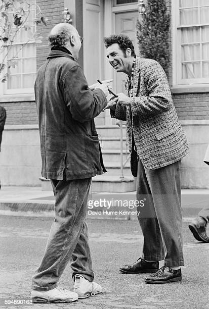 'Seinfeld' cocreator Larry David and actor Michael Richards who plays 'Kramer' talk on the set in between filming the last episode of 'Seinfeld'...