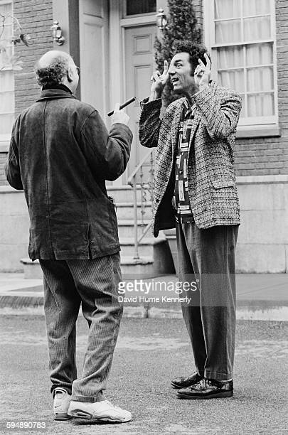'Seinfeld' cocreator Larry David and actor Michael Richards who plays 'Kramer' talk on the set in between filming the last episode of the hit...