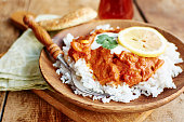 Seitan Tikka Masala on rice with soy yogurt and served with paratha bread