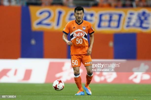 Seitaro Tomisawa of Albirex Niigata in action during the JLeague J1 match between Albirex Niigata and Omiya Ardija at Denka Big Swan Stadium on June...