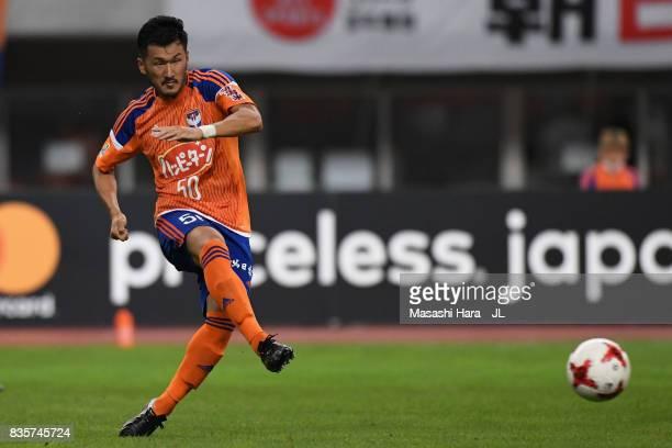Seitaro Tomisawa of Albirex Niigata in action during the JLeague J1 match between Albirex Niigata and Vegalta Sendai at Denka Big Swan Stadium on...