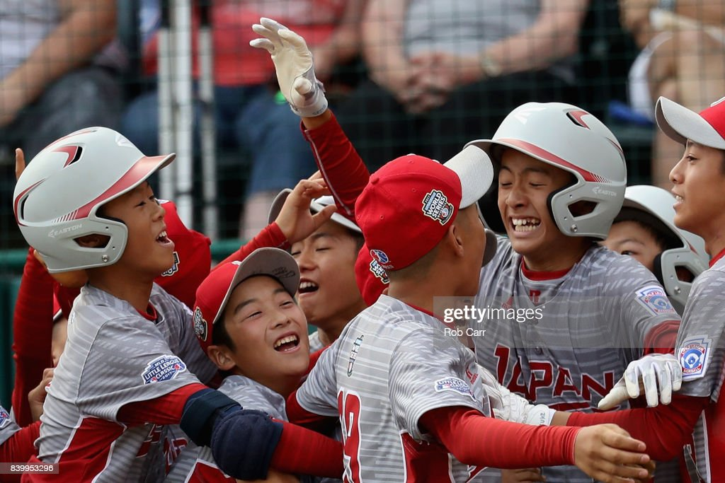Seiya Arai #14 of Japan celebrates scoring the game ending run during their 12-2 win over the Southwest Team from Texas during the Champioinship Game of the Little League World Series at Lamade Stadium on August 27, 2017 in South Williamsport, Pennsylvania.