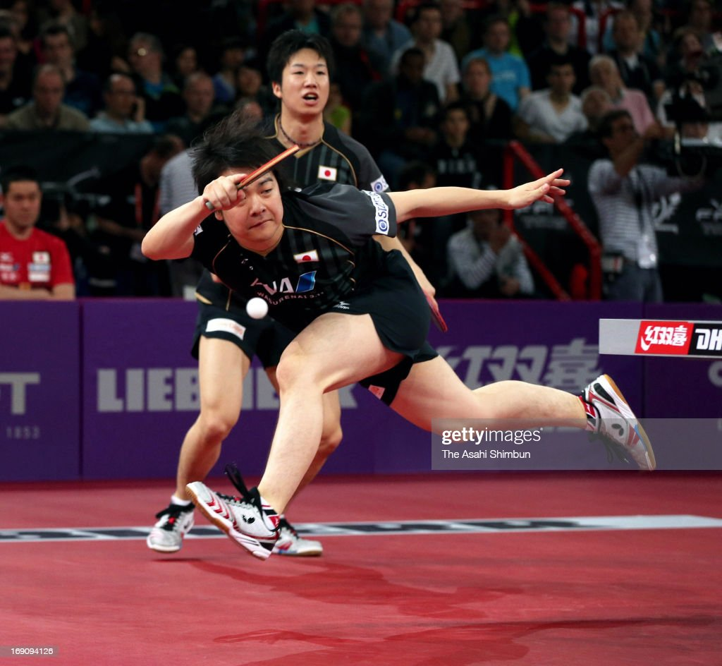 Seiya Kishikawa (L) and Jun Mizutani of Japan competes in the Men's Doubles Semi Final match against Hao Shuai and Ma Lin of China during day six of the World Table Tennis Championships on May 18, 2013 in Paris, France.