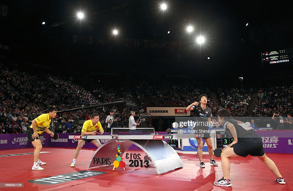 Seiya Kishikawa and Jun Mizutani of Japan competes in the Men's Doubles Semi Final match against Hao Shuai and Ma Lin of China during day six of the World Table Tennis Championships on May 18, 2013 in Paris, France.