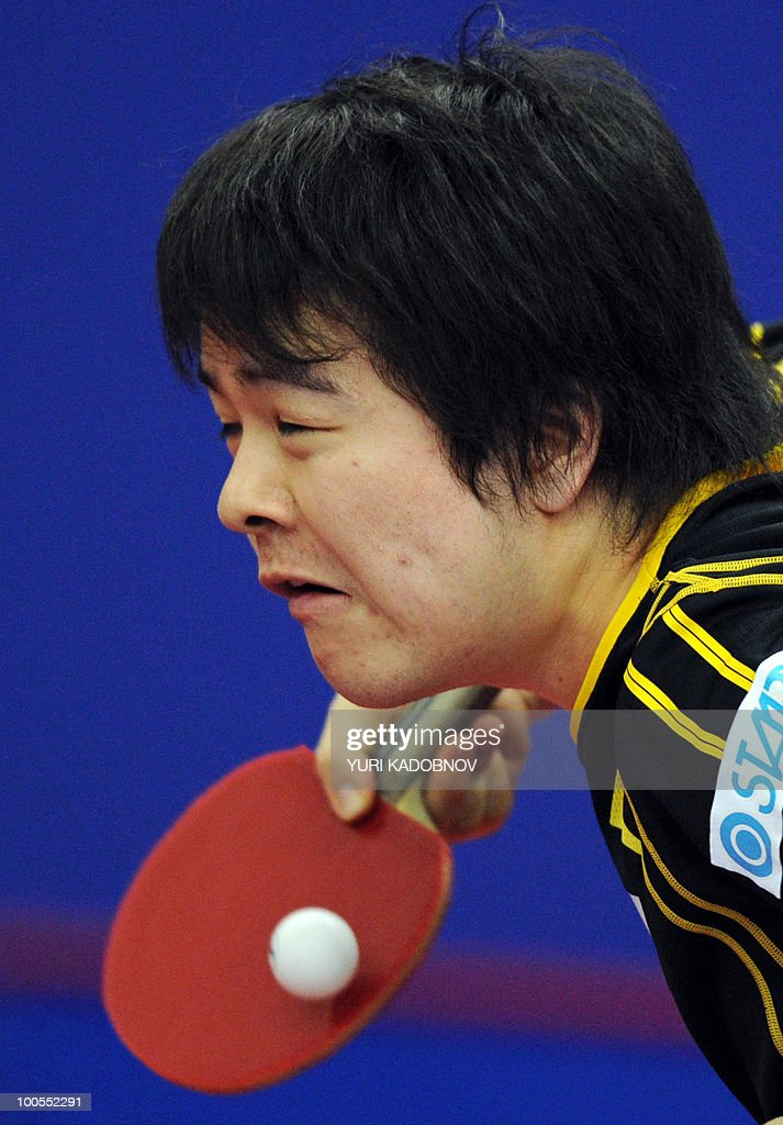 Seiya Kishikawa of Japan returns a service to Allan Bentsen of Denmark (unseen) during their men's teams group C match at the 2010 World Team Table Tennis Championships in Moscow on May 25, 2010.