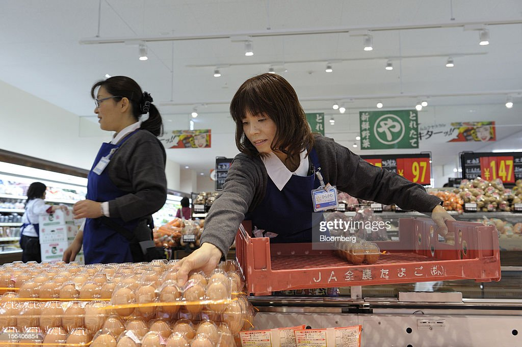 A Seiyu GK employee arranges eggs in the company's supermarket in Tokyo, Japan, on Wednesday, Nov. 14, 2012. Seiyu GK is a unit of Wal-Mart Stores Inc. Photographer: Akio Kon/Bloomberg via Getty Images