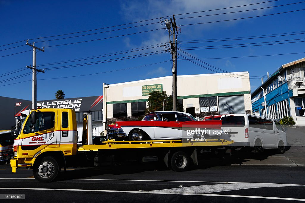 Seized cars are removed from premises on Marua Road in Ellerslie on July 28 2015 in Auckland New Zealand Police have raided more than 30 Head Hunters...