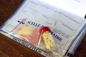 Seized doping products in a judicial sealed bag are pictured on November 14 in Arcueil a Paris suburb at the 'Office Central de Lutte contre les...
