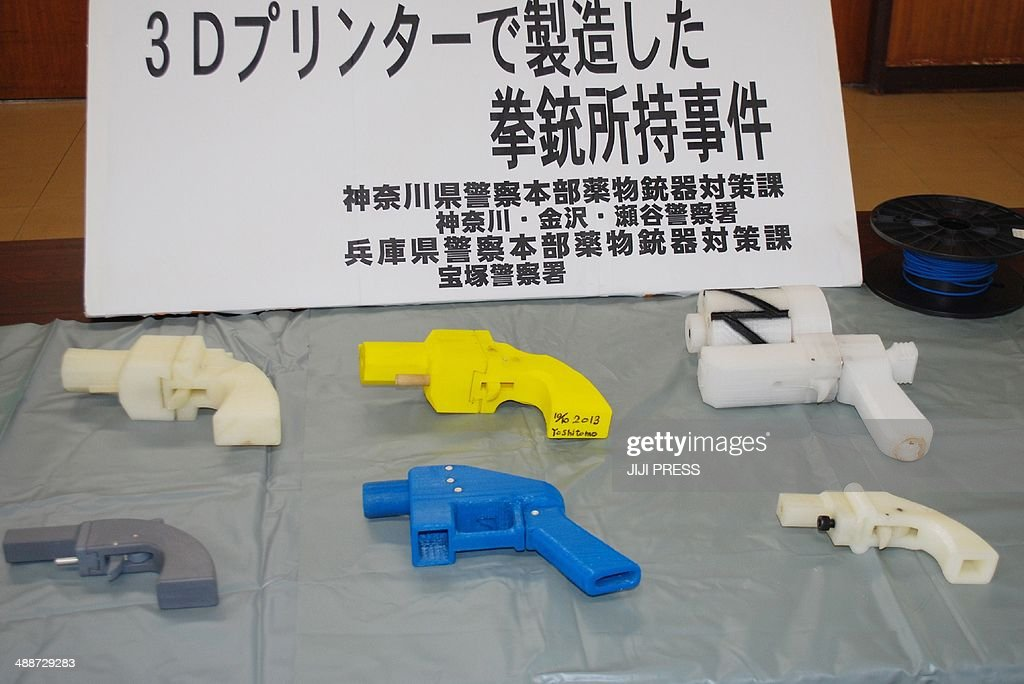 Seized plastic made guns produced by a 3-D printer are displayed at a police station in Yokohama on May 8, 2014. A Japanese man suspected of possessing guns made with a 3-D printer has been arrested in what was said to be the country's first such detention. Officers who raided the home of Yoshitomo Imura, a 27-year-old college employee, confiscated five weapons, two of which had the potential to fire lethal bullets.
