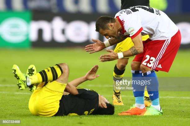 Sejad Salihovic of Hamburg argues with Shinji Kagawa of Dortmund during the Bundesliga match between Hamburger SV and Borussia Dortmund at...