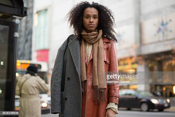 Sejahari Saulter is seen on Michigan Avenue wearing a rust leather Topshop jacket thrifted scarf and shoes and blue denim HM jeans on December 19...
