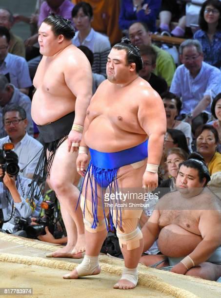 Sekiwake Kotoshogiku reacts after his victory over ozeki Goeido during day ten of the Grand Sumo Nagoya Torunament at Aichi Prefecture Gymnasium on...