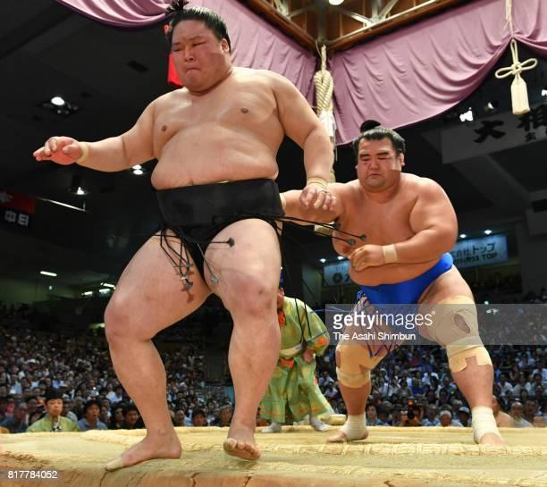 Sekiwake Kotoshogiku sends ozeki Goeido out of the ring to win during day ten of the Grand Sumo Nagoya Torunament at Aichi Prefecture Gymnasium on...