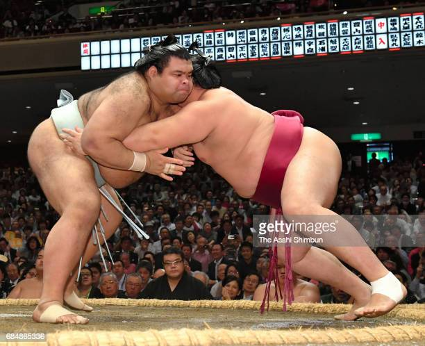 Sekiwake Takayasu and Endo compete during day five of the grand Sumo Summer Tournament at Ryogoku Kokugikan on May 18 2017 in Tokyo Japan