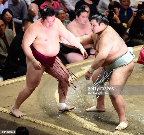 Sekiwake Takayasu pushes Endo out of the ring to win during day five of the grand Sumo Summer Tournament at Ryogoku Kokugikan on May 18 2017 in Tokyo...
