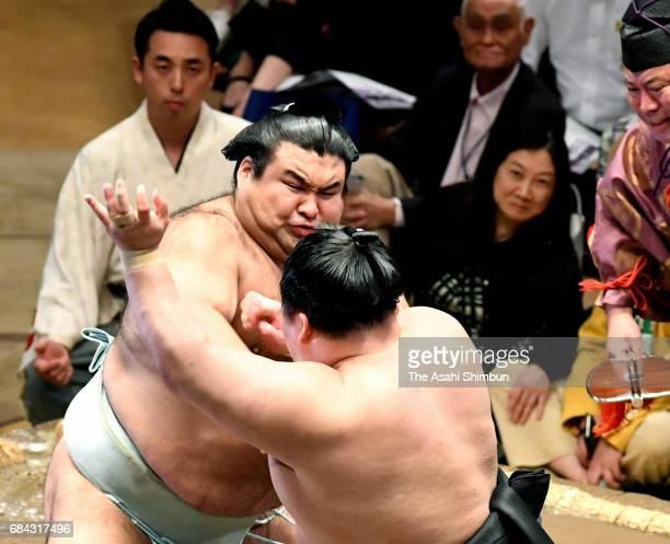 Sekiwake Takayasu pushes Ozeki Goeido out of the ring to win during day two of the Grandu Sumo Summer Tournament at Ryogoku Kokugikan on May 15 2017...