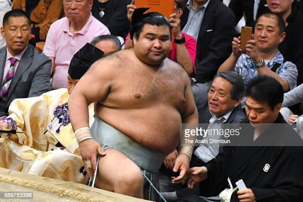 Sekiwake Takayasu reacts after his defeat by Shodai during day fourteen of the Grand Sumo Summer Tournament at Ryogoku Kokugikan on May 27 2017 in...