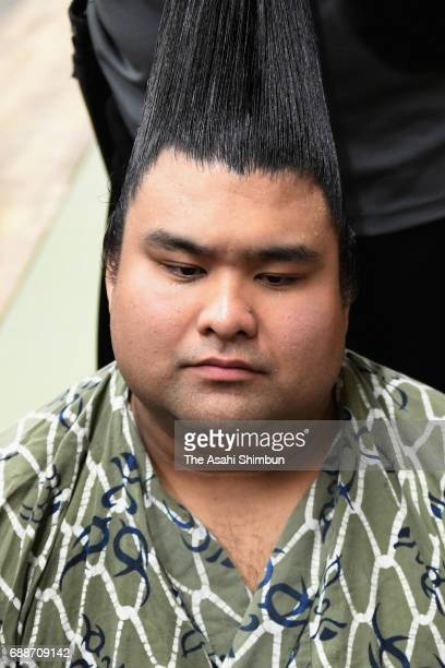Sekiwake Takayasu responds a question while having his topknot arranged after his victory over Mongolian yokozuna Harumafuji in the dressing room...