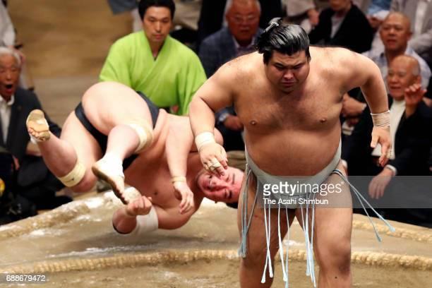 Sekiwake Takayasu throws Mongolian yokozuna Harumafuji to win during day thirteen of the Grand Sumo Summer Tournament at Ryogoku Kokugikan on May 26...