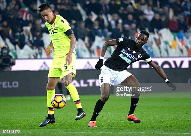 Seko Mohamed Fofana of Udinese Calcio competes with Erikck Pulgar of Bologna FC during the Serie A match between Udinese Calcio and Bologna FC at...