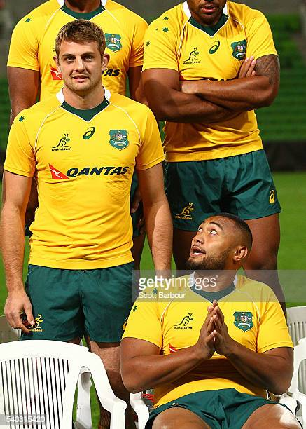 Sekope Kepu and Dean Mumm of the Wallabies look on during a Wallabies team photo at AAMI Park on June 15 2016 in Melbourne Australia