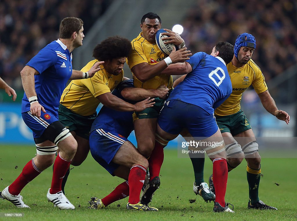 Sekope Kepu of Australia is tackled by Louis Picamoles of France during the Autumn International match between France and Australia at Stade de France on November 10, 2012 in Paris, France.
