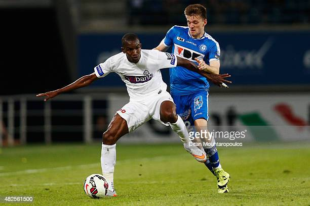 Sekou Cisse of Genk battles for the ball with Thomas Foket of Gent during the Jupiler League match between KAA Gent and KRC Genk held at the Ghelamco...