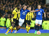 Sekou Sanogo Junior of BSC Young Boys and Leon Osman of Everton compete for the ball during the UEFA Europa League Round of 32 match between Everton...