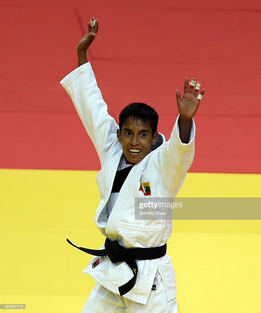 Sel Wee of Burma celebrates after she defeated Nacy Quillotes Lucero of the Philippines during the Final of the Women's 45 kg Judo Competition during the 2013 SEA Games on December 18, 2013 in Nay Pyi Taw, Burma.