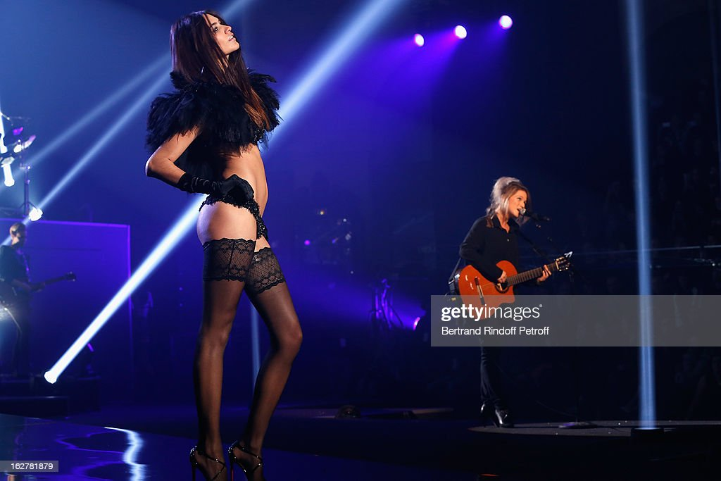 Selah Sue (R) performs during the Etam Live Show Lingerie at Bourse du Commerce on February 26, 2013 in Paris, France.
