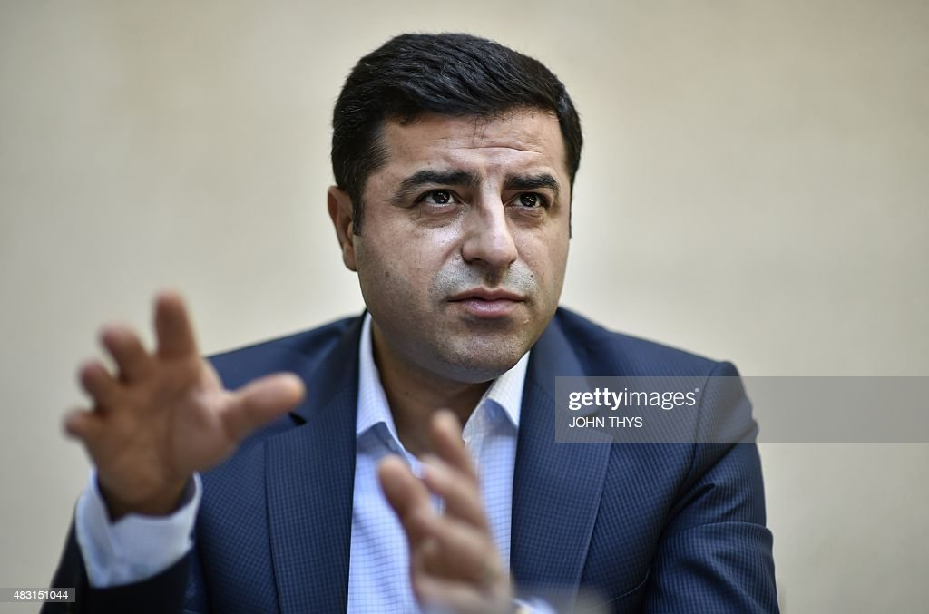 Selahattin Demirtas, co-leader of Turkey's pro-Kurdish People's Democratic Party (HDP), speaks during an interview with AFP in Brussels on August 6, 2015. Demirtas urged the world to denounce Ankara's new 'unjust war' on rebel Kurds and asked the EU to push clearly for a truce.